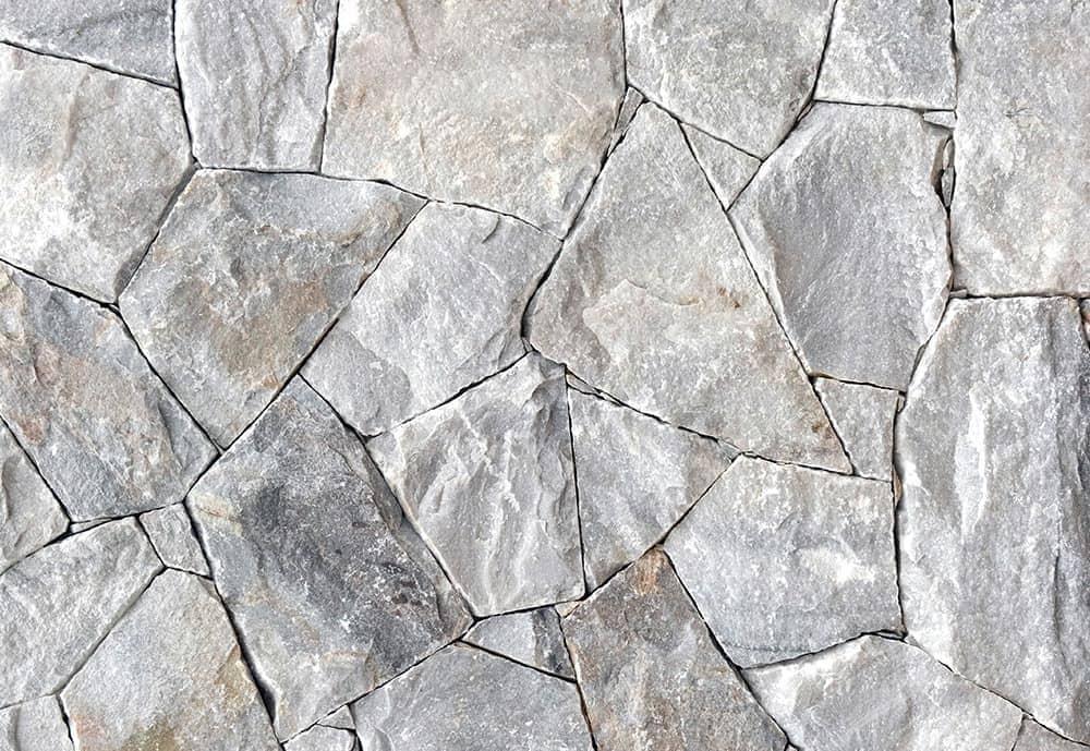 plēsts akmens sienam žogiem